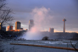 Mist of Horseshoe Falls from upstream with Niagara Falls, Ontario in background, Skylon Tower