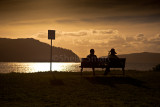 Couple on bench at Pittwater