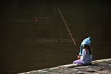 Girl fishing at Akuna Bay