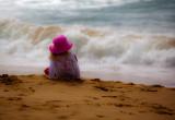 Little girl watching the surf at Palm Beach
