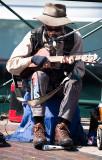 Busker on guitar