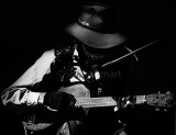 Country and western guitarist in monochrome