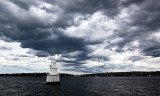 Sydney Harbour marker with approaching stormclouds