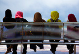 Five girls in hijab on bench