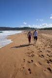 Couple walking on beach at Palm Beach, Sydney