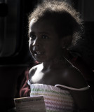Little backlit girl on ferry