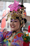 Vietnamese dancer in colourful dress and headress