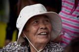 Elderly Asian lady in hat