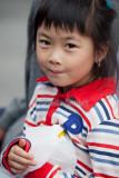 Little girl posing at festival