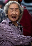Laughing Asian lady at Lunar festival