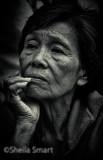 Pensive Asian lady in mono