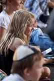 Little girl in crowd watching busker
