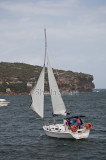 Yacht coming about on Sydney Harbour