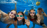 Children swimming underwater in pool 5/02/2012
