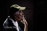 Smoking man in street