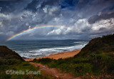 Warriewood storm with rainbow over Pacific Ocean
