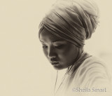 Girl in turban in sepia