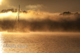 Yacht and rolling mist in Bay of Islands, New Zealand
