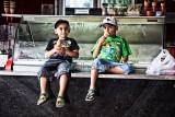 Two little boys eating icecream