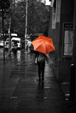 Orange umbrella on a wintry day