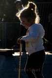 Backlit little girl at skate park