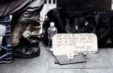 Sign of homeless man
