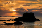 113.15 - Silver Bay: Offshore Rock Silhouette At Sunrise