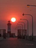 96.3 - Duluth:  North Breakwater Lighthouse With Sun