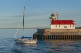 93.31 - Duluth:  Sailboat Leaving Harbor, Shortly Before Sunset