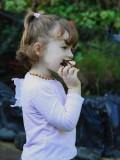 Enjoying cake... Little Isabella..