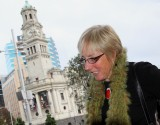 Lady in Aotea Square, with Town Hall in Background.