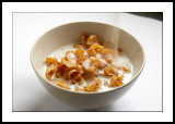 Pouring milk over cereals