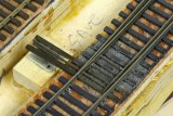 Z-scale throwbars, electrical switch in place