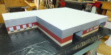 Overall view on table saw of warehouse with facade