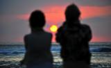 Enjoying sunset together, Pauoa, Hawaii