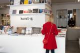 Red-coated shopper at Konst-ig
