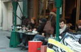 Outdoor cafes are crowded despite temperatures in the 40°s F (~6° C)