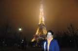 Sam and the Eiffel Tower on a foggy night