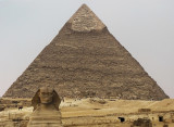 Bracing himself for the throngs, the Sphinx looks tense. View from outside low-walled area.