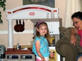 Andie showing Bachi her kitchen