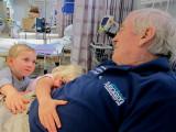 Charli and Toby loving Pop at hospital