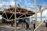 Barn raising. A community effort.