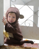 The little monkey tries to sneak out the door.