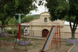 Iglesia y Parque Infantil en los Alrededores del Poblado