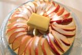 Fan apple wedges, sprinkle w/sugar & top w/butter