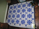 My third - and favorite - queen-size quilt, being basted on our living room floor.