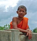 Novice monk at riverside