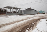 Moosonee station: covered structure, new shed, newly sided station and freight/express building