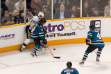 Sidney Crosby and Jonathan Cheechoo fight for the puck
