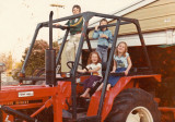 Driving tractor with her cousins